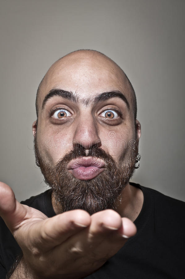 Download Man With A Bushy Beard That Blows A Kiss Stock Image - Image of close, nice: 19896803
