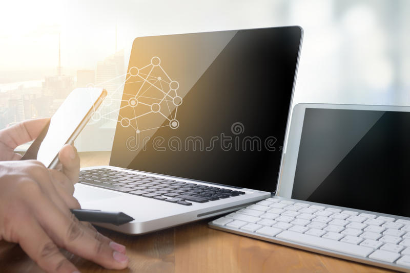 man of business man hand working on laptop computer on wooden de royalty free stock images