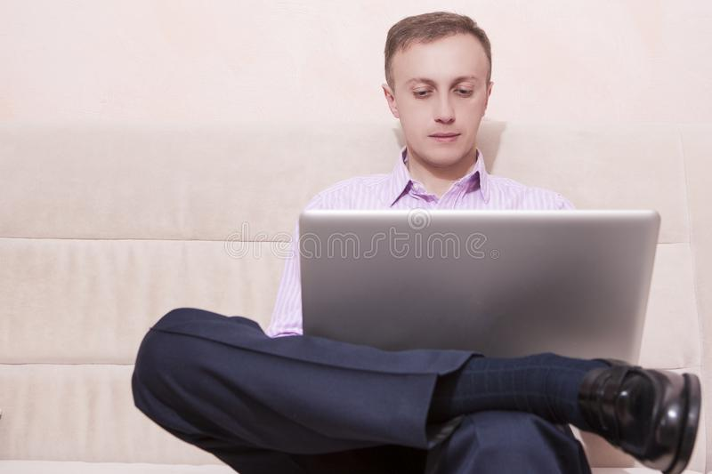 Man in Business Style Clothing and Formal Penny Loafers royalty free stock image