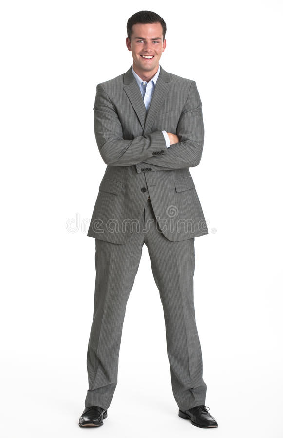 Man in Business Suit. A young man is wearing a business suit and smiling at the camera. Vertically framed shot stock photography