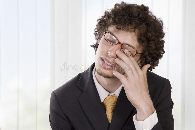 Man In Business Suit Massaging His Eye To Relieve Stock Images