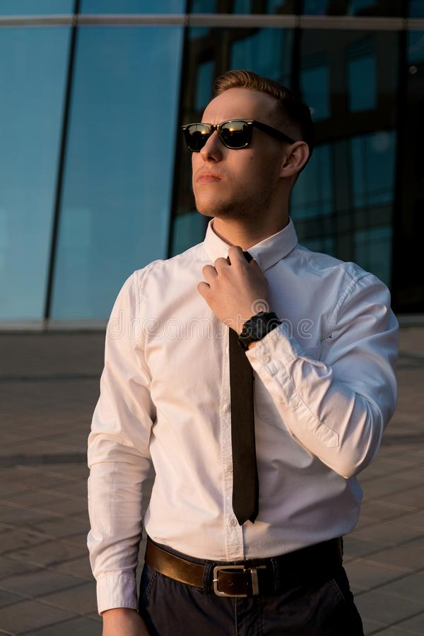 Businessman on the street in sunglasses royalty free stock photos