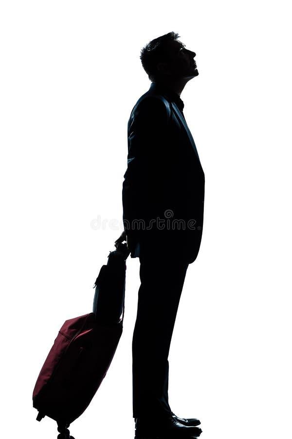 Man business traveler waiting looking up stock photography