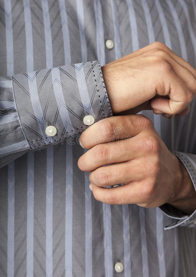 Close up detail of man`s hands buttoning shirt cuffs. Businessman getting ready for work. Men`s clothing apparel. vector illustration