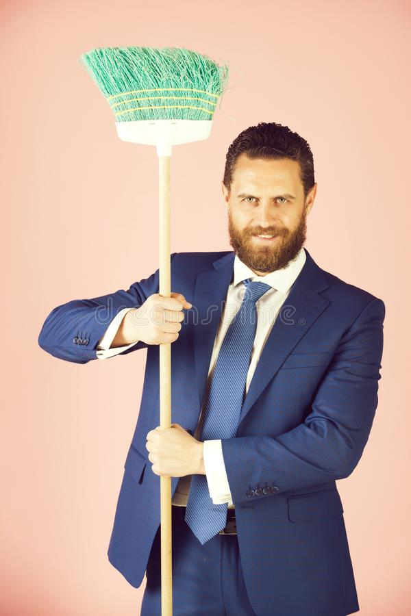 Man or businessman with happy face, broom in business outfit royalty free stock photos