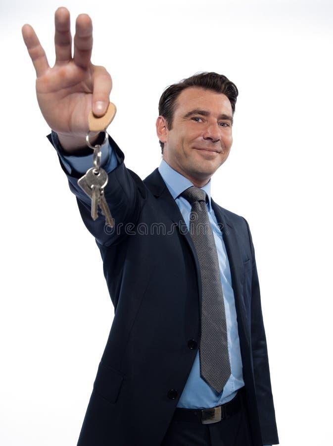 Man Businessman realtor teasing holding keys stock images