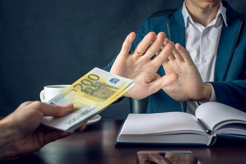 Man businessman in suit refuses to take the money by showing that he is not a grafter. Concept of corruption and bribery royalty free stock photos
