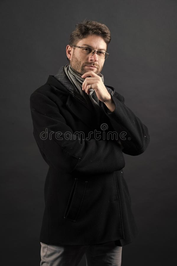 Man businessman think in glasses on bearded face in coat. Man businessman think in glasses on bearded face in black coat. Business, vision, solution concept stock images
