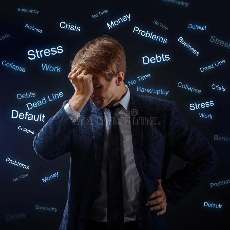 Man businessman under stress. Many problems, concept. A young guy in business suit is upset and grabbed his head. Head around a lot of fluorescent labels for stock photos