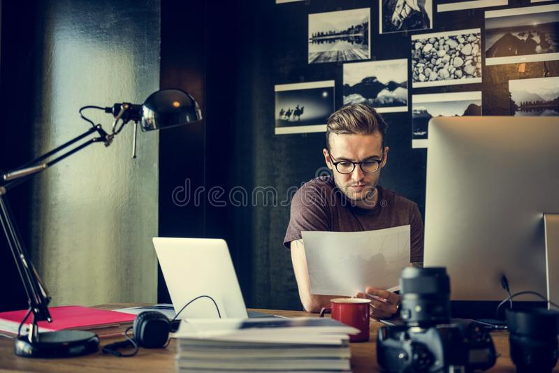 Man Busy Photographer Editing Home Office Concept. Busy Photographer Editing Home Office Concept royalty free stock photography