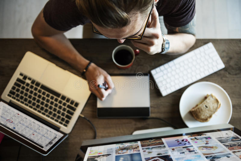 Man Busy Photographer Editing Home Office Concept stock images