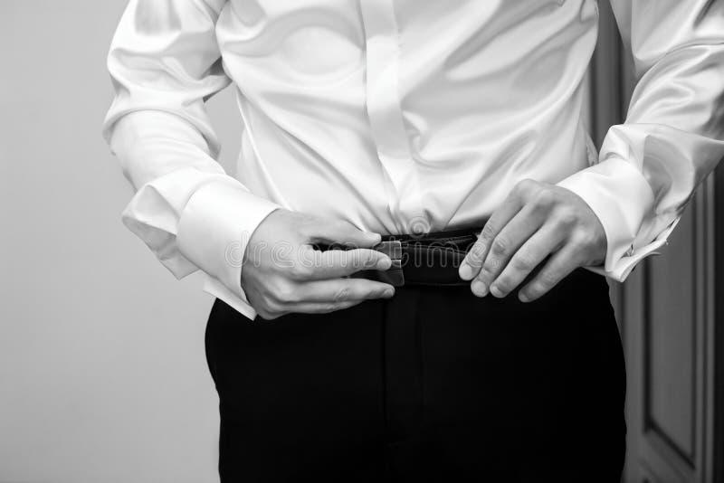 Man buttons white shirt stock photo