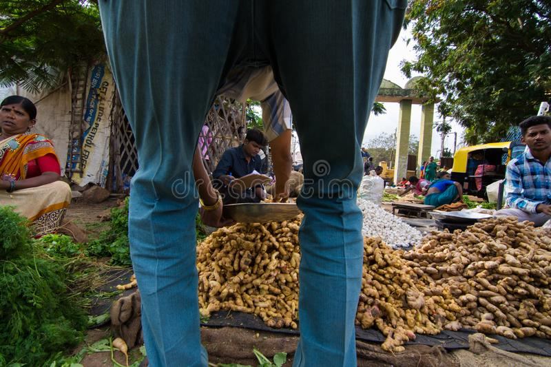 Man buy ginger from seller in local morning market at Hostpet ,Karnataka South India. stock photo