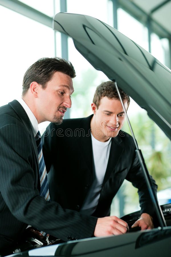 Download Man Buying Car From Salesperson Stock Photo - Image: 15996012