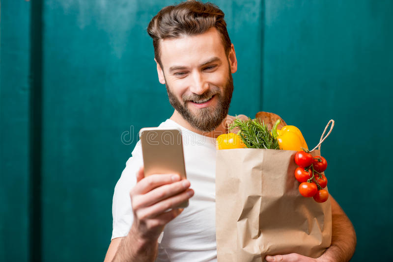 Man buying food online stock images