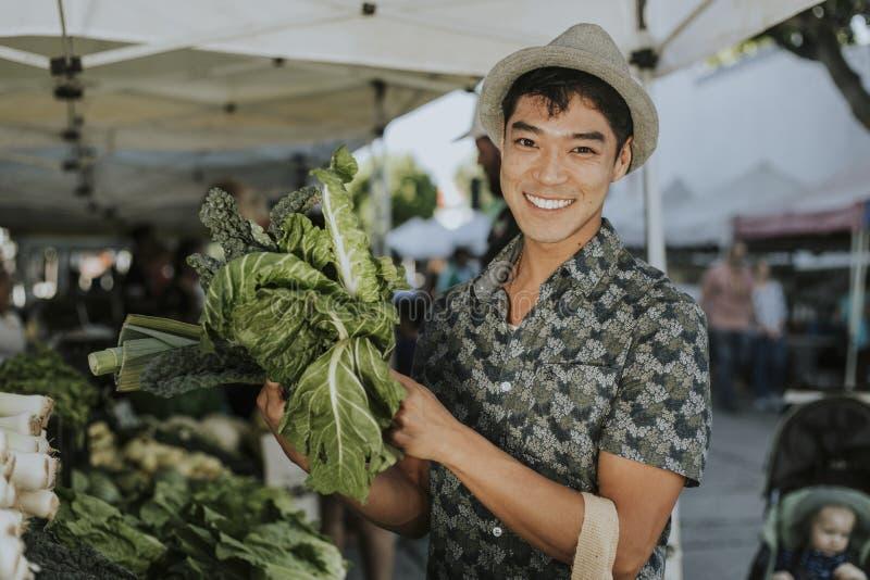 Man buying kale at a farmers market royalty free stock photos