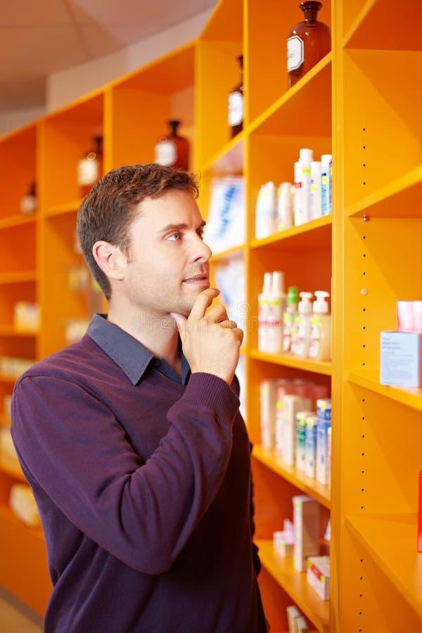 Download Man Buying Medicine In Pharmacy Stock Image - Image: 21736443