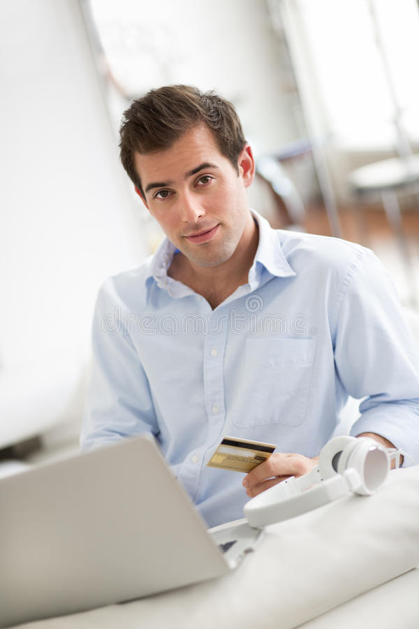 Download A Man Buys Music Online On Computer, At Home Stock Image - Image: 33172517