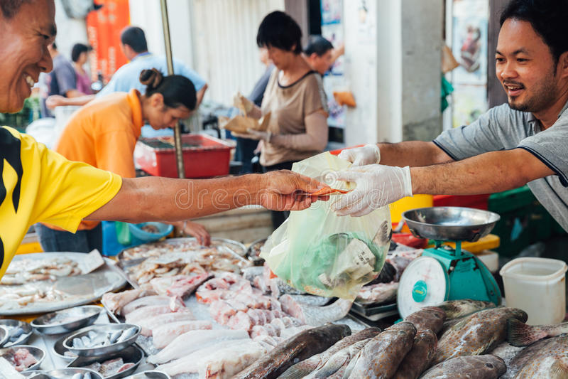 Man buys seafood at the local market stock photo