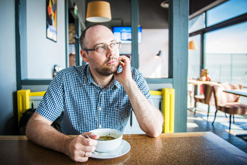 Man in a cafe stock image