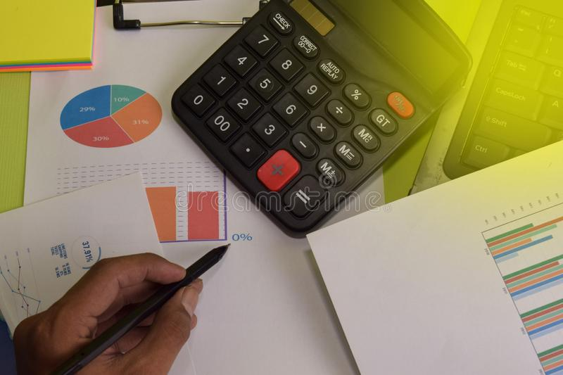 Man calculate budget cost and analysis financial. Business and finance concept of office desk stock photo
