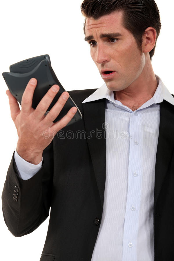 Man calculating his budget. For the month royalty free stock photo