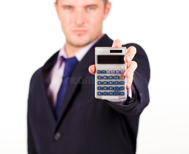 Man with a calculator. Young business man with a calculator stock image