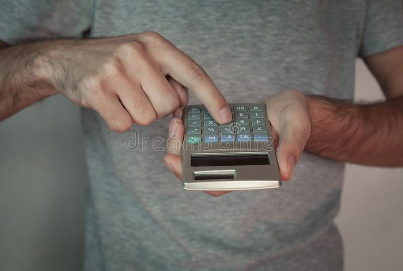 Man with calculator. Business concept royalty free stock photos