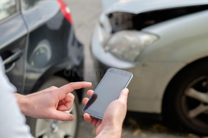 Man calling car mechanic insurance assistance. Mobile phone help calling after a car accident royalty free stock photography
