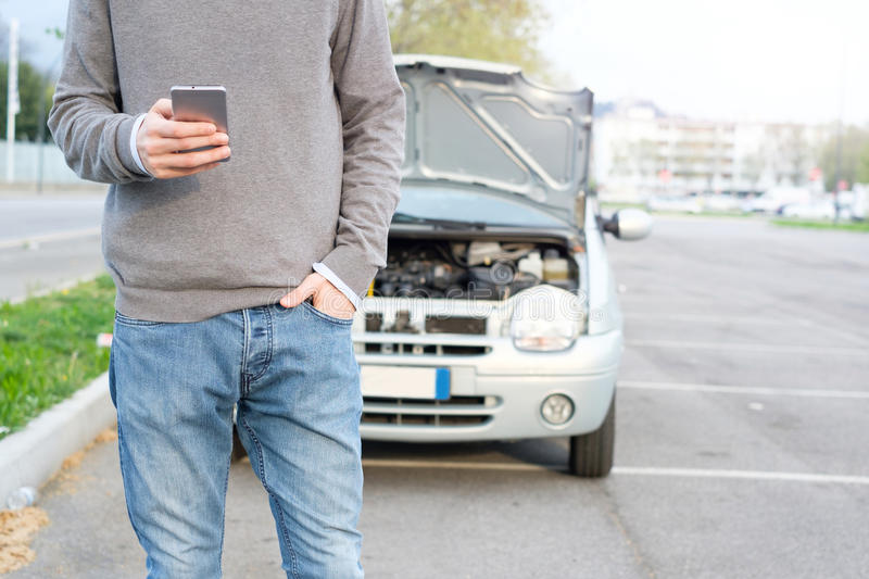 Man calling mechanic after car breakdown stock photos