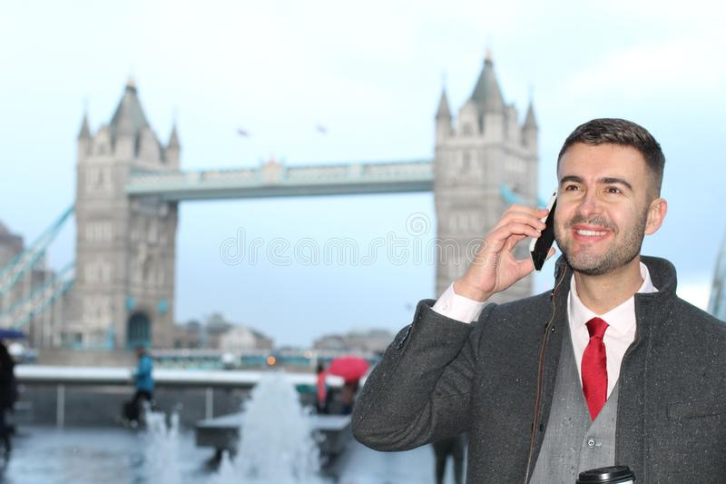 Man calling during rainy day in London royalty free stock image