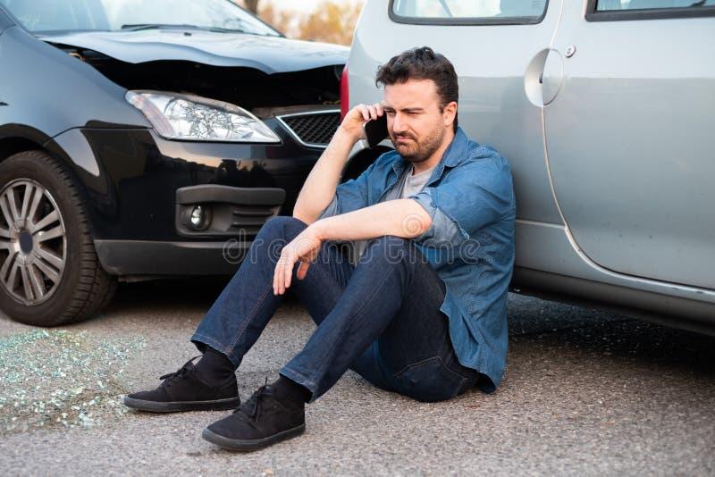 Man calling roadside service after car crash royalty free stock photography