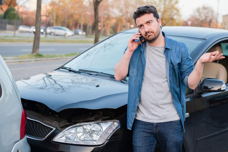 Man calling roadside emergency after car accident royalty free stock photo