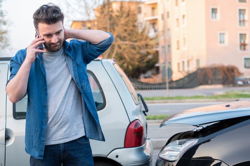 Man calling roadside service after car crash stock images