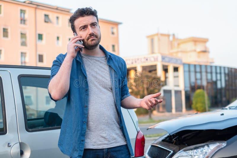 Man calling roadside service after car crash royalty free stock images