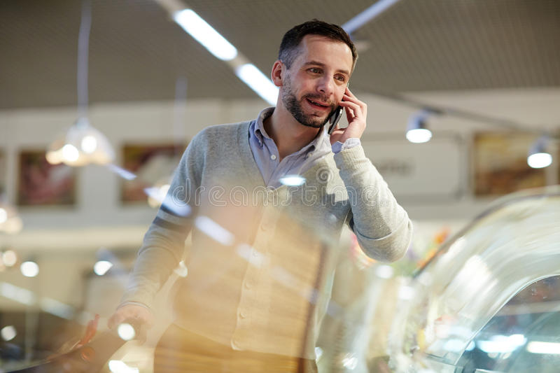 Man Calling Wife from Grocery Store stock photo