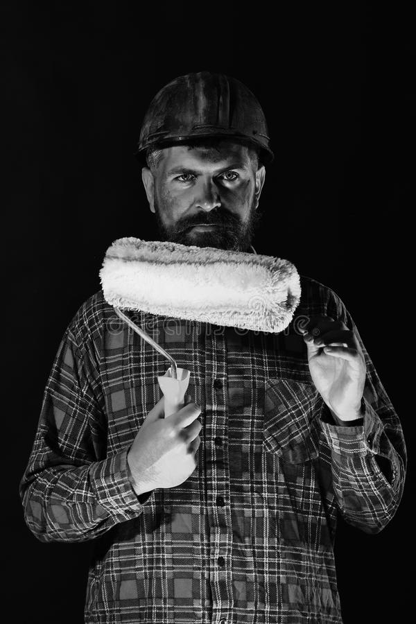 Man with calm face expression isolated on black background. Construction and hard work concept. Builder or painter with stock photos