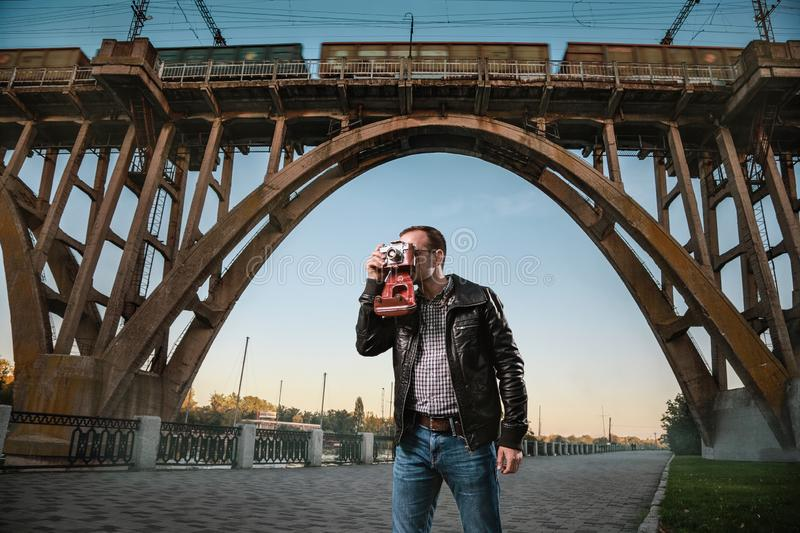 Man with a camera in the city royalty free stock photo
