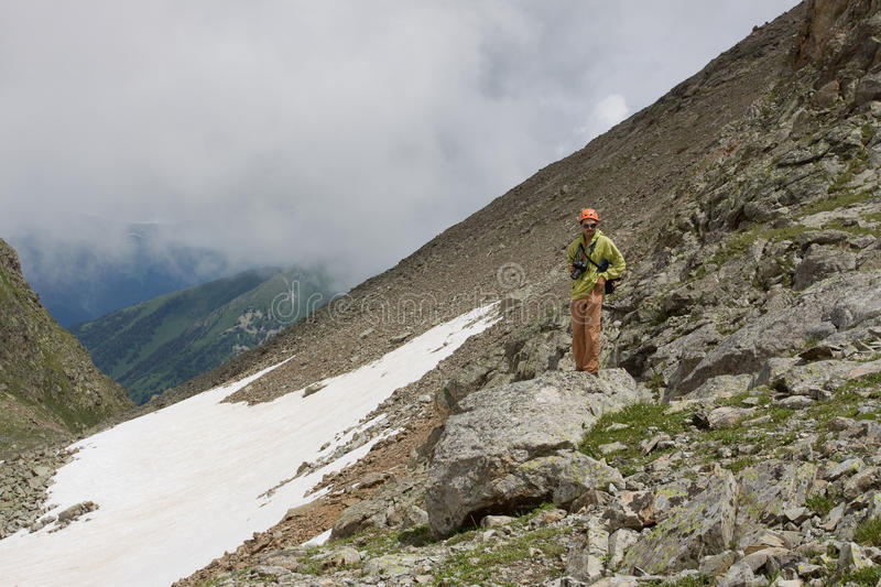 Download Man With Camera In Mountains. Stock Photo - Image: 15638808