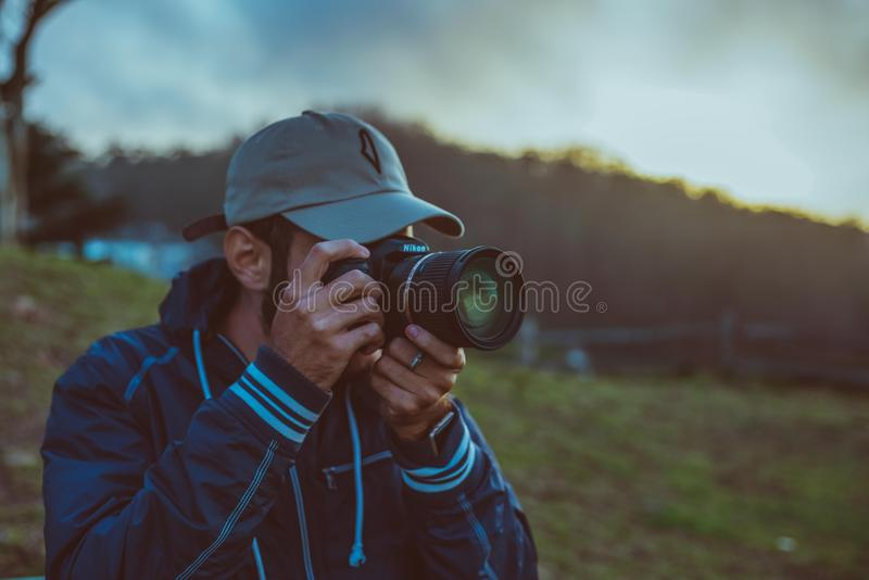 Man with camera outdoors royalty free stock photo