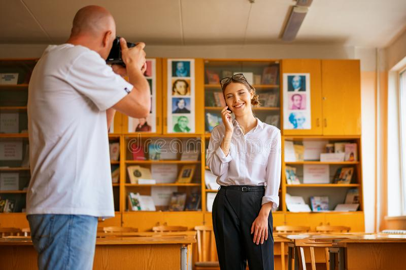 A man with a camera taking pictures of a girl, a professional photo shoot. A men with a camera taking pictures of a girl, a professional photo shoot stock photos