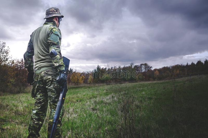Man in Camouflage Soldier Suit While Holding Black Hunting Rifle stock photography
