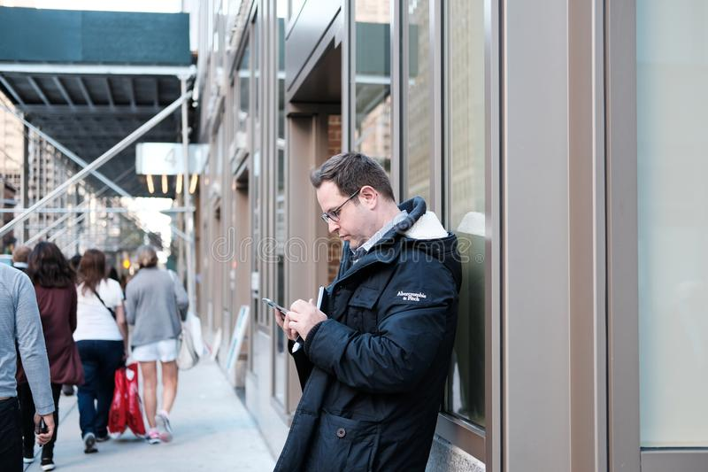 Man seen using a smartphone in a city. royalty free stock photo