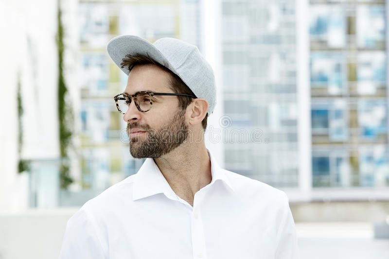 Man in cap and spectacles stock images