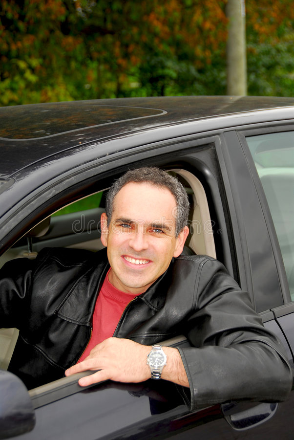 Download Man in car stock photo. Image of looking, smiling, driving - 1344932