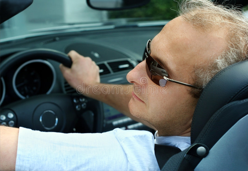 Man in the car stock photography