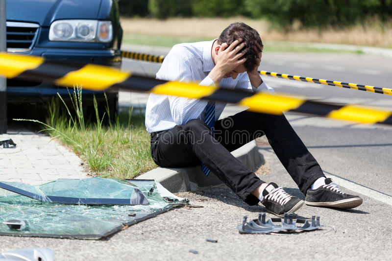 Man after car accident. Horizontal view of man after car accident royalty free stock images