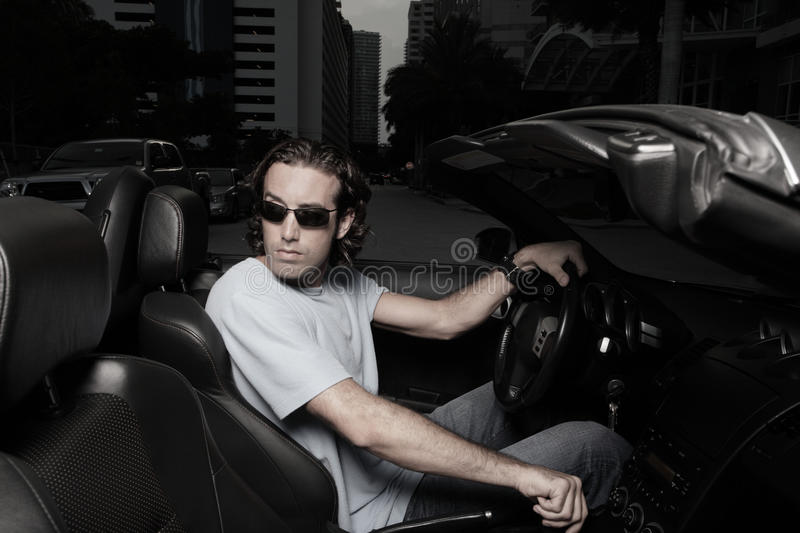 Man in a car backing up royalty free stock photography