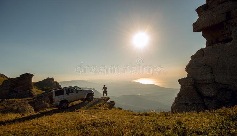 Man with car on beauty nature landscape background. Horizontal photo, holiday travel concept royalty free stock photos