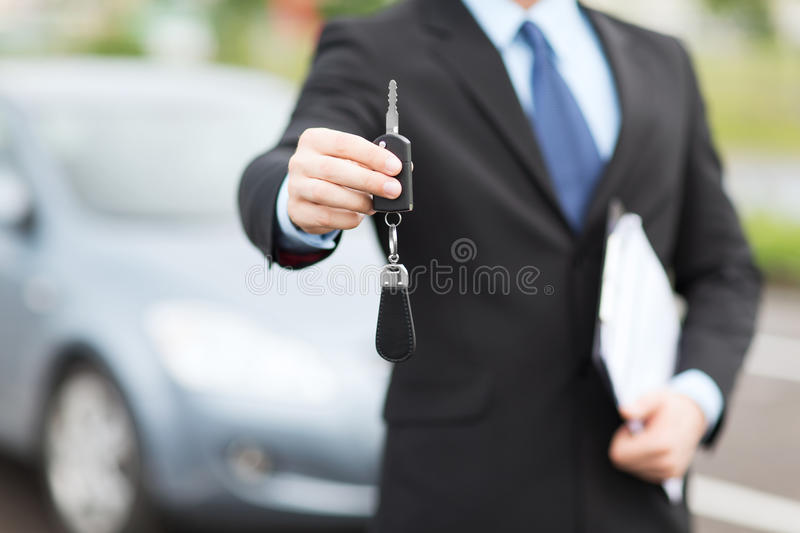 Man with car key outside. Transportation and ownership concept - man with car key outside stock photos